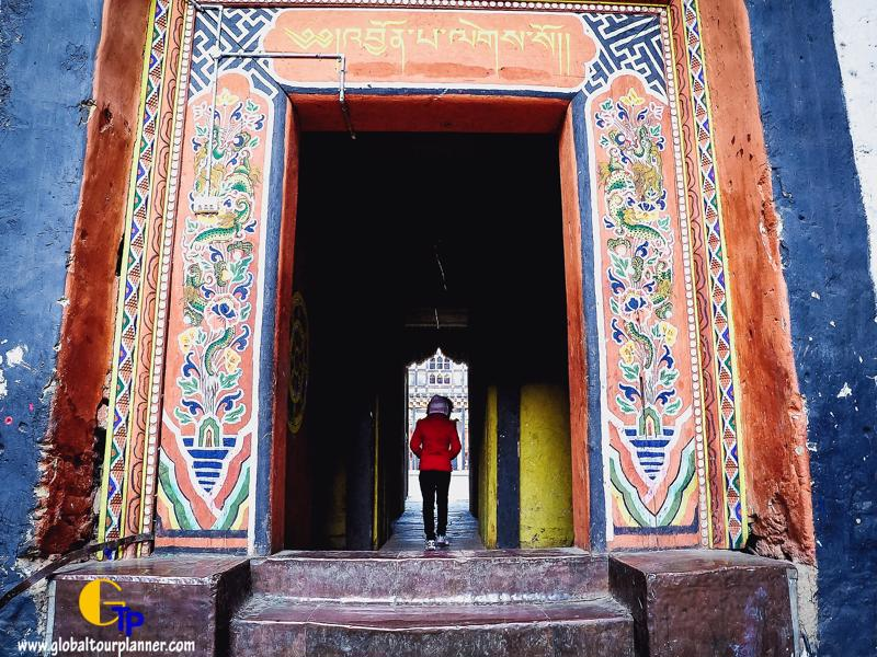 A lady walking inside a monasery in Bumthang Bhutan